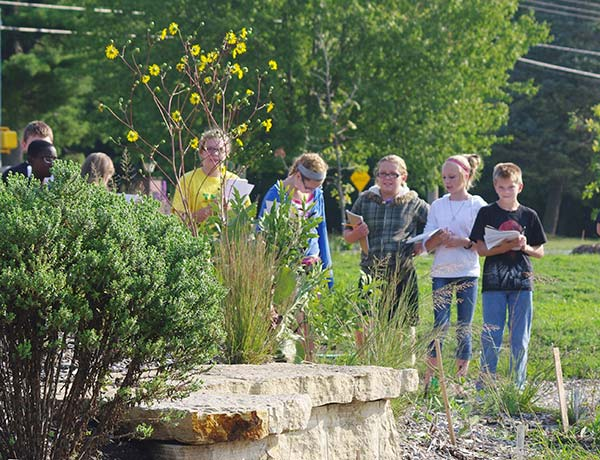Students-at-Aldo-Leopold-Middle-School-Prairie-classroom,-learning-the-difference-betweeen-prairie-dock-and-compass-plant..jpg