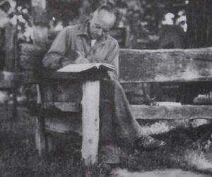 Aldo-Leopold-on-salvaged-wood-bench.jpg
